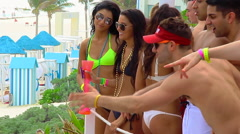 Young people dancing during Spring Break - stock footage