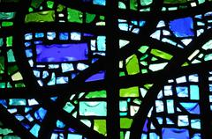 stained glass window of Trebeurden church in Bretagne - stock photo