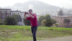 Man Takes A Walk In Alamo Square In San Francisco, Takes A Selfie - stock footage