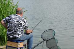 France, a fisherman near Sautour pond in Les Mureaux Stock Photos