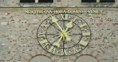 Latin inscription above old clock in Trier, Germany Stock Footage