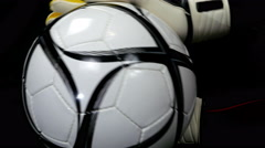 Soccer/football goalkeeper hands with gloves catch a ball, close up, 4k Stock Footage
