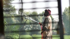 South Asian Farmer Waters his Plants - stock footage
