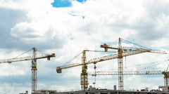 Construction site with cranes and blue sky background with downward movement. Stock Footage