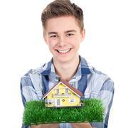 Man holding a miniature house Stock Photos