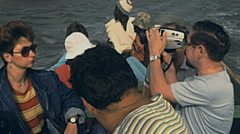 Senegal 1985: european tourists during a boat trip Stock Footage