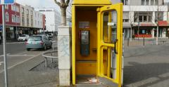 Yellow telephone booth with open door Stock Footage