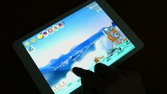 Man playing angry birds on a Tablet PC Stock Footage