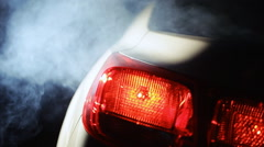 Car taillight smoke Stock Footage
