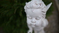 Sculpture of an angel in the yard Stock Footage