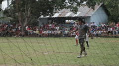 Goalkeeper on the field during a match in the jungle Stock Footage