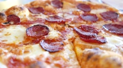 4k Ultra HD video of a freshly baked traditional thin crust pizza with pepperoni Stock Footage