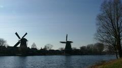 Two Classic Dutch Windmills - stock footage