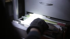 Burglar going through Filing Cabinet Stock Footage