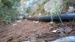 Plastic pipe on the earth's surface Stock Footage