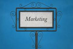 "The Word ""Marketing"" on a Signboard Stock Photos"