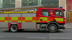 A fire truck pulling over the construction area Stock Footage