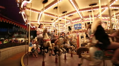 Carousel. Horses on a carnival Merry Go Round Stock Footage