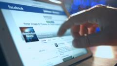Man reads the news on Facebook Stock Footage