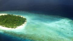 Maldives Atolls - the aerial view from the sea plane of a coral reef island Stock Footage