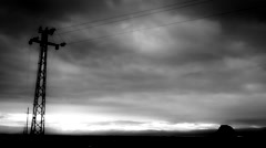 Electric poles in the  field black & white Stock Footage