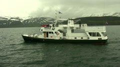 Whale watching boat in Iceland long shot Dalvik Stock Footage