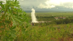 The Strokkur Geyser erupting near Reykjavik in Iceland long shot Stock Footage