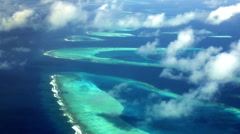 Maldives Atolls - the aerial view from the sea plane of a coral reef Stock Footage