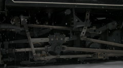 Steam and smoke of old historic locomotive. close up of wheels Stock Footage