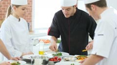 Chef teaching students how to prepare dish - stock footage