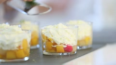Cook rubbing lemon zest with grater over dessert - stock footage