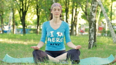 Young Calm Woman Meditating While Sitting In Yoga Position At Park, Outdoors HD Stock Footage