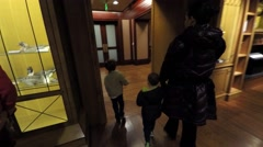 A family at a museum time lapse Stock Footage