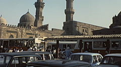 Cairo 1970s: busses in front of Mosques of Middle Est Stock Footage