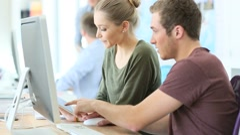 Teacher helping students in digital design - stock footage