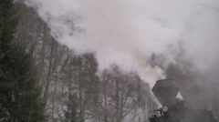 Close up detail of steam pipes of an old train puffing - stock footage