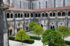 the cloister of Alcobaca monastery in Portugal - stock photo