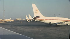Egypt 1970s: Egyptair aircrafts parked in the strip of Cairo airport Stock Footage