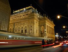 Night tram at the National Theatre in Prague Stock Photos