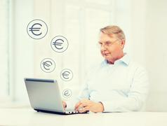 Old man in eyeglasses working with laptop at home Stock Illustration