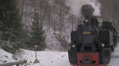 VISEU, ROMANIA - JAN 2: View of an old traditional steam engine called MOCANITA Stock Footage
