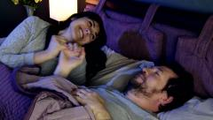 Couple in bedroom at night making peace after fight Stock Footage