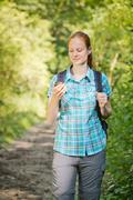 Hiker Navigating with Digital Maps - stock photo