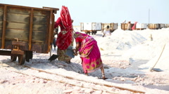 Indian women mining and hauling salt Stock Footage