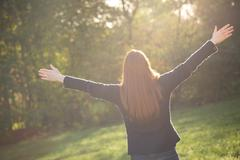 Rejoice in Nature - Woman in a Park - stock photo
