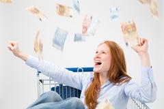 Money Falling Over a Happy Woman - stock photo