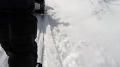 Cross country skiing from behind low shot gimbal - stock footage