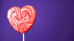 lollipop in the form of a heart - stock footage