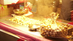 Vendor making dumplings at Lehua Night Market Stock Footage