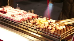Vendor cooking meat with blowtorch at Lehua Night Market Stock Footage